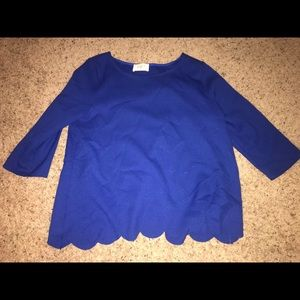 Blue top, has a open back covered by scallops